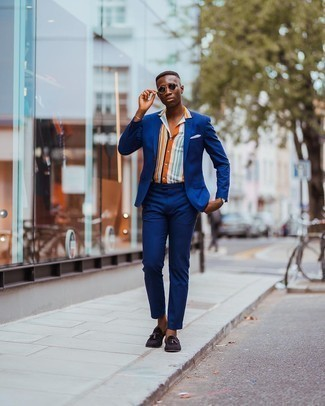 Dark Brown Suede Tassel Loafers Outfits: This combo of a blue suit and a multi colored vertical striped short sleeve shirt can only be described as incredibly stylish and casually classic. Infuse a hint of polish into this look by slipping into a pair of dark brown suede tassel loafers.