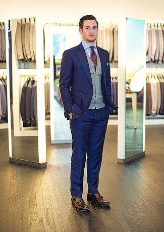 How to Wear a Grey Sweater Vest For Men: We're loving how this combination of a grey sweater vest and a navy suit immediately makes men look elegant and stylish. Go down a more casual route when it comes to footwear by slipping into dark brown leather double monks.