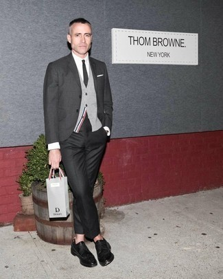 Charcoal Suit Outfits: A charcoal suit and a grey sweater vest are absolute essentials if you're crafting a polished wardrobe that matches up to the highest sartorial standards. Finishing with a pair of black leather brogues is a guaranteed way to introduce a dose of stylish casualness to this outfit.