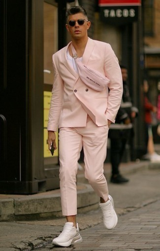 How to Wear a Pink Suit: This pairing of a pink suit and a white tank might pack a punch, but it's also super easy to wear. Send your look in a sportier direction by rocking a pair of white athletic shoes.