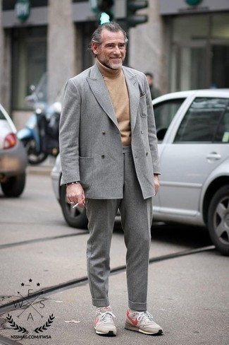 How to Wear Beige Athletic Shoes For Men: Pairing a grey wool suit and a tan wool turtleneck is a surefire way to infuse your current styling arsenal with some masculine elegance. To introduce a more relaxed feel to your look, complete this outfit with beige athletic shoes.
