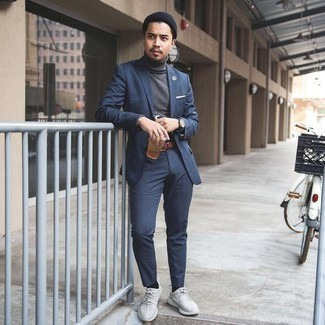 Belt Outfits For Men: This casual pairing of a navy suit and a belt can take on different moods depending on the way it's styled. If you wish to immediately tone down this getup with a pair of shoes, add white athletic shoes to this ensemble.