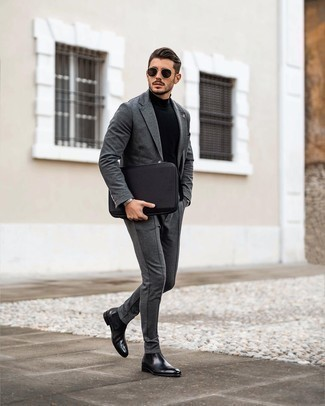 Charcoal Suit with Black Leather Chelsea Boots Outfits: You'll be amazed at how easy it is to get dressed like this. Just a charcoal suit and a black turtleneck. As for shoes, add a pair of black leather chelsea boots to your ensemble.