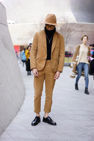 How to wear: tan corduroy suit, black turtleneck, black leather derby shoes, tan wool hat