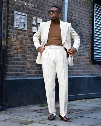 Brown Turtleneck Outfits For Men: This classy combo of a brown turtleneck and a white suit will hallmark your outfit coordination skills. Now all you need is a nice pair of burgundy leather double monks to round off your ensemble.