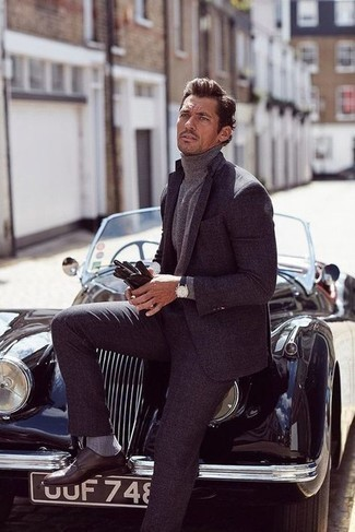 Gloves Outfits For Men: This casual pairing of a charcoal suit and gloves comes in useful when you need to look stylish in a flash. To give this look a more sophisticated twist, complement your ensemble with a pair of dark brown leather double monks.