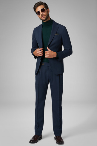 How to wear: navy suit, dark green turtleneck, dark brown leather loafers, olive paisley pocket square
