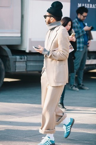 Beige Suit Outfits: This pairing of a beige suit and a grey wool turtleneck speaks sophistication and versatility. Finishing with a pair of aquamarine suede low top sneakers is an easy way to add a fun touch to this look.