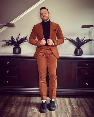Tobacco Suit Outfits: We love how this pairing of a tobacco suit and a dark brown turtleneck instantly makes any guy look stylish and classy. Why not introduce black canvas low top sneakers to the equation for a dose of stylish effortlessness?