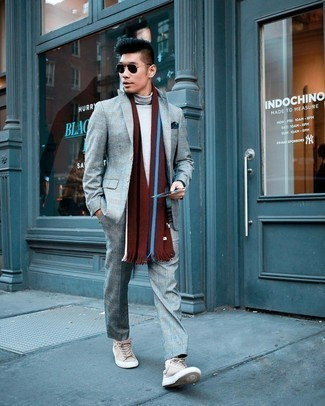 Scarf Outfits For Men: If you like practical outfits, wear a grey plaid suit with a scarf. We adore how complete this outfit looks when rounded off with a pair of beige suede low top sneakers.