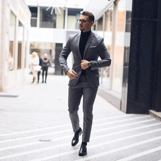 How to wear: grey suit, black turtleneck, black leather oxford shoes, white pocket square