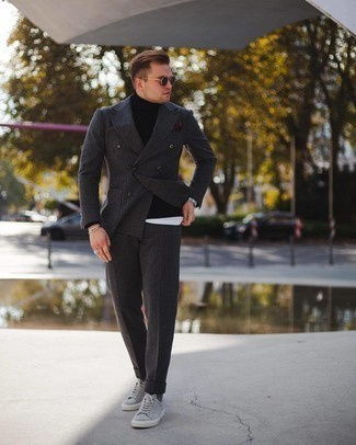 Black Turtleneck Outfits For Men: For a look that's pared-down but can be styled in many different ways, opt for a black turtleneck and a charcoal vertical striped wool suit. Does this look feel all-too-perfect? Invite a pair of grey suede low top sneakers to jazz things up.
