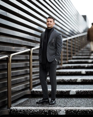 How to wear: charcoal suit, black turtleneck, black leather tassel loafers, black scarf