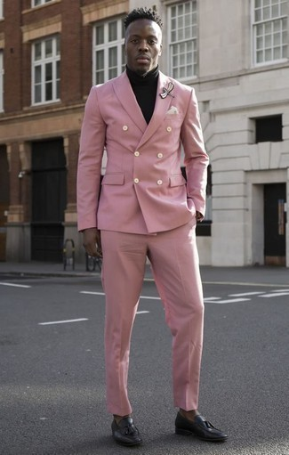 How to Wear a Pink Suit: A pink suit looks so classy when teamed with a black turtleneck for an ensemble worthy of a complete gent. Black leather tassel loafers integrate seamlessly within a myriad of getups.