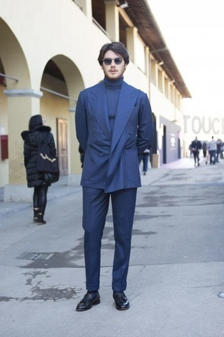 How to Wear a Blue Vertical Striped Suit: Teaming a blue vertical striped suit and a blue turtleneck is a surefire way to breathe class into your day-to-day styling repertoire. Navy leather tassel loafers will infuse an added touch of refinement into an otherwise mostly dressed-down ensemble.