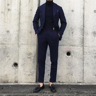 Navy Suit Outfits: We're loving the way this pairing of a navy suit and a navy turtleneck immediately makes a man look stylish and sophisticated. When not sure as to what to wear on the footwear front, complete your outfit with black leather tassel loafers.