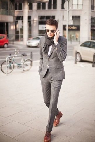 Something as simple as opting for a grey wool suit and a grey v-neck jumper can potentially set you apart from the crowd. Mix things up by wearing brown leather dress boots.
