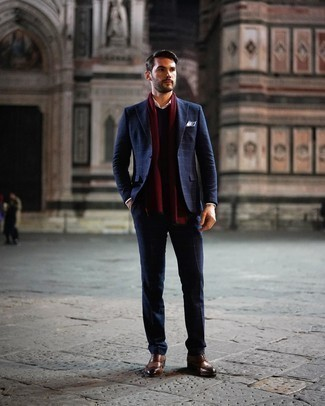 Brown Leather Brogues Outfits: For an effortlessly neat getup, consider teaming a navy check suit with a navy v-neck sweater — these items fit nicely together. Complete this ensemble with a pair of brown leather brogues et voila, this ensemble is complete.