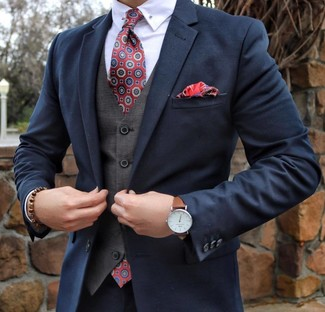 How to wear: navy suit, grey waistcoat, white dress shirt, red print tie