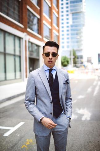 How to wear: grey wool suit, navy vertical striped waistcoat, light blue dress shirt, black polka dot tie