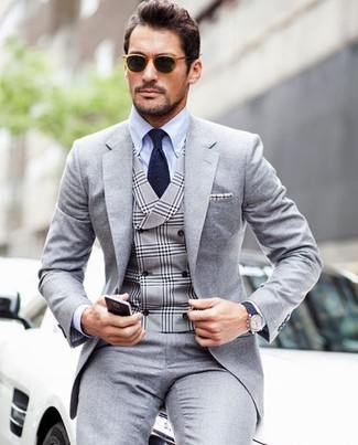 How to wear: grey suit, grey plaid waistcoat, light blue dress shirt, navy tie
