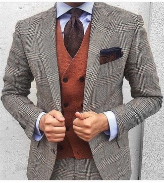 How to Wear a Dark Brown Print Pocket Square: A grey houndstooth wool suit and a dark brown print pocket square are indispensable menswear must-haves if you're figuring out a casual wardrobe that matches up to the highest style standards.