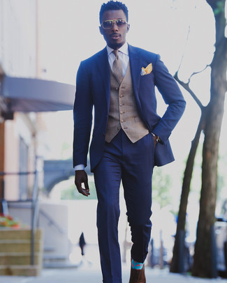How to wear: blue suit, brown plaid waistcoat, white dress shirt, brown leather oxford shoes
