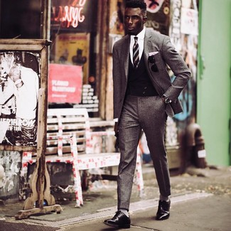 How to wear: grey wool suit, black waistcoat, white dress shirt, black leather derby shoes