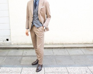 How to wear: tan suit, grey plaid waistcoat, light blue dress shirt, dark brown leather oxford shoes