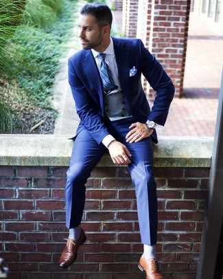 How to wear: blue suit, grey waistcoat, white dress shirt, brown leather oxford shoes