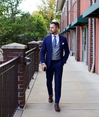 How to wear: navy suit, grey waistcoat, white dress shirt, dark brown leather oxford shoes