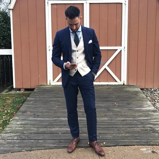 How to wear: navy suit, beige waistcoat, light blue dress shirt, brown leather oxford shoes