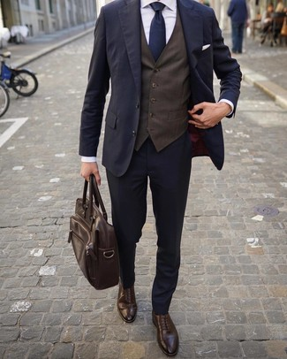 How to wear: navy suit, dark brown waistcoat, white dress shirt, dark brown leather brogues