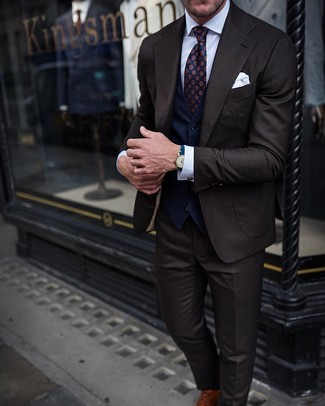 How to wear: dark brown suit, navy waistcoat, white dress shirt, brown leather oxford shoes
