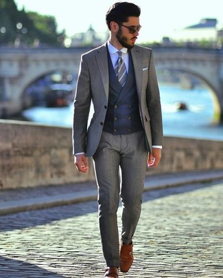 Men's Looks & Outfits: What To Wear In 2020: A grey suit and a navy waistcoat are among the key elements of a properly balanced closet. Want to play it down on the shoe front? Complete your look with a pair of tobacco leather double monks for the day.