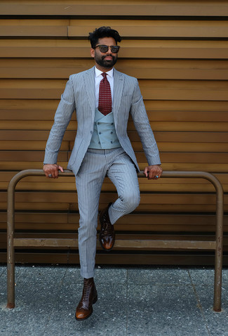 How to wear: light blue vertical striped suit, light blue waistcoat, white dress shirt, dark brown leather brogue boots