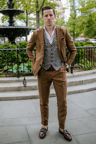 Men's Looks & Outfits: What To Wear In Fall: This pairing of a brown suit and a black and white gingham waistcoat is a real life saver when you need to look seriously smart and refined. For times when this look is too much, play it down by rocking a pair of dark brown leather tassel loafers. There's no better way to brighten up a bleak fall day than a seriously stylish outfit like this one.