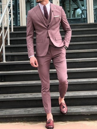 How to Wear a Pink Suit: This pairing of a pink suit and a pink waistcoat will add sophisticated essence to your getup. A pair of burgundy leather tassel loafers immediately amps up the appeal of this outfit.