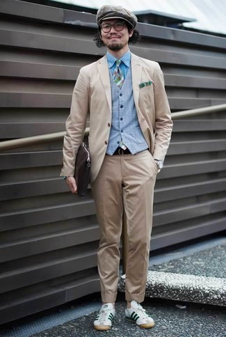 How to Wear a Light Blue Waistcoat: This is solid proof that a light blue waistcoat and a beige suit look amazing when paired together in a polished getup for today's gentleman. When this getup looks all-too-polished, dress it down by wearing a pair of white and green leather low top sneakers.