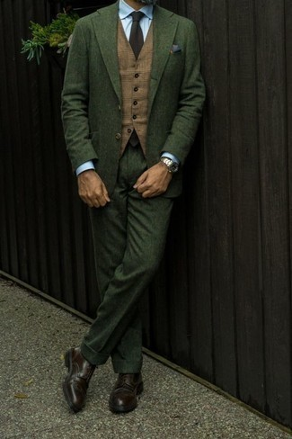 How to Wear a Dark Green Suit: This getup proves it pays to invest in such elegant menswear pieces as a dark green suit and a tan plaid waistcoat. Dark brown leather brogues are an effective way to punch up your ensemble.