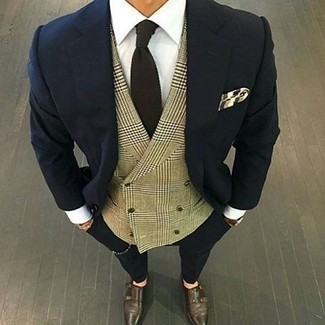 How to Wear a Dark Brown Tie For Men: A navy suit and a dark brown tie are absolute must-haves if you're picking out a classy wardrobe that holds to the highest men's fashion standards. Feeling inventive? Break up your outfit by rocking dark brown leather double monks.
