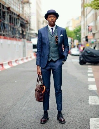 How to Wear Burgundy Leather Derby Shoes: For a look that's polished and totally camera-worthy, pair a navy suit with a blue waistcoat. And if you want to immediately dial down your outfit with one item, complete this ensemble with burgundy leather derby shoes.