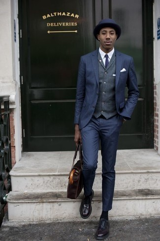Navy Waistcoat Outfits: Dress in a navy waistcoat and a navy suit to look like a true dandy at all times. For times when this look looks all-too-classic, tone it down by wearing a pair of burgundy leather brogues.
