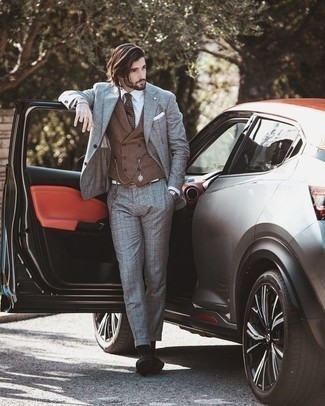 Check Suit Outfits: You'll be surprised at how super easy it is to get dressed this way. Just a check suit and a brown waistcoat. Finishing with a pair of black leather derby shoes is a guaranteed way to infuse a dose of stylish effortlessness into your ensemble.