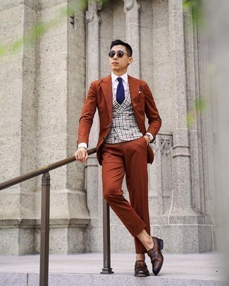 Tobacco Suit Outfits: This pairing of a tobacco suit and a grey gingham waistcoat will add sophisticated essence to your look. A pair of dark brown leather monks easily ups the street cred of your outfit.