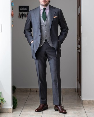 Charcoal Suit Outfits: Putting together a charcoal suit with a grey wool waistcoat is a good choice for a stylish and classy look. Put a dressed-down spin on an otherwise traditional ensemble with dark brown leather oxford shoes.