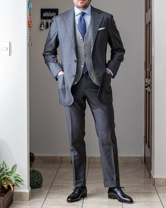 Charcoal Suit Outfits: Hard proof that a charcoal suit and a grey wool waistcoat are amazing when matched together in a polished getup for a modern gent. If you want to easily play down your ensemble with a pair of shoes, complete your ensemble with a pair of black leather oxford shoes.
