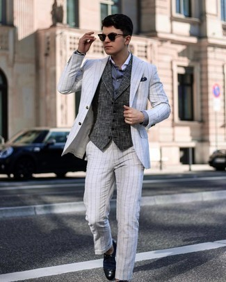 Men's Outfits 2021: Try teaming a white vertical striped suit with a charcoal houndstooth wool waistcoat for a truly stylish outfit.