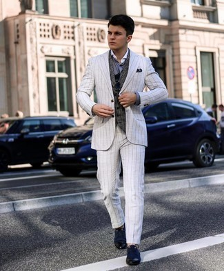 Men's Outfits 2021: Make a grey vertical striped suit and a charcoal houndstooth wool waistcoat your outfit choice to be the picture of classy men's style. Go the extra mile and spice up your outfit by finishing with navy canvas derby shoes.