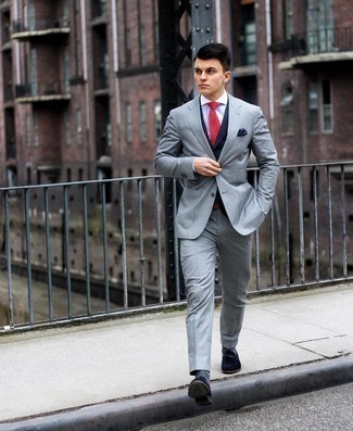 Grey Suit Outfits: Dress in a grey suit and a navy waistcoat for rugged elegance with a modernized spin. For footwear, you could stick to the casual route with navy suede loafers.
